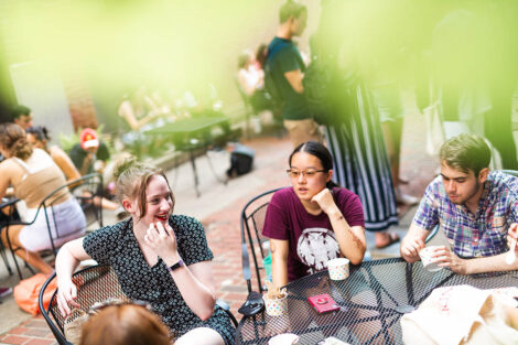 A group of students talk at a table in downtown Easton.