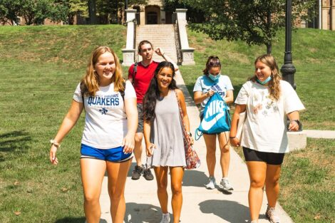 A group of students walk in front of Pardee Hall.