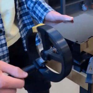 VIMSIM student demonstrating tool by turning a black wheel