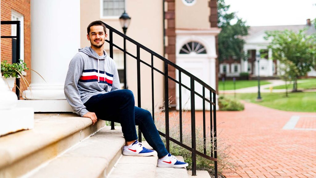 Antonie sits on the steps at South College
