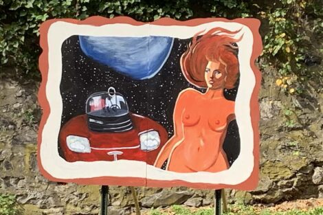 Billboard of a woman in space being pursued by a Tesla astronaut