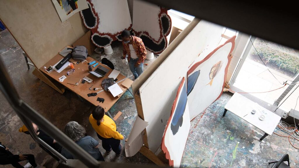 Looking down over the studio spaces as students work and talk