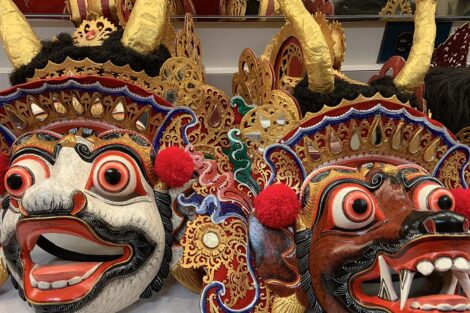 Handmade masks with brightly colored faces and eyes used by the Balinese musical group Cudamani
