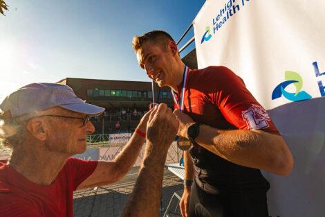Nathan Keller '23 accepts second place medal men's novice race.
