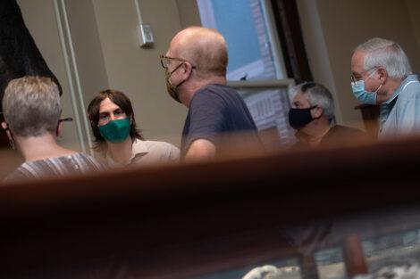 Families inside of Van Wickle Hall, masked.