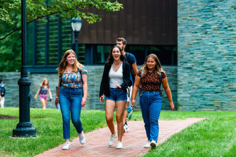Students walk next to Skillman Library.