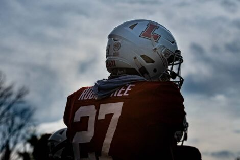 The back of a football player in uniform.