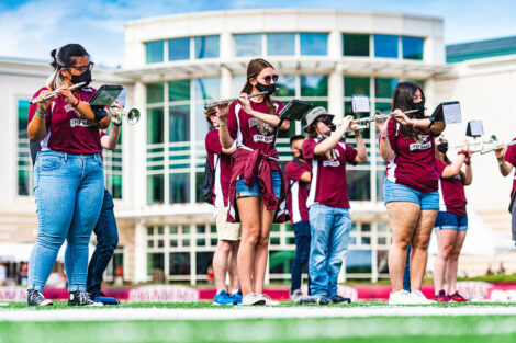 Band members play flutes.