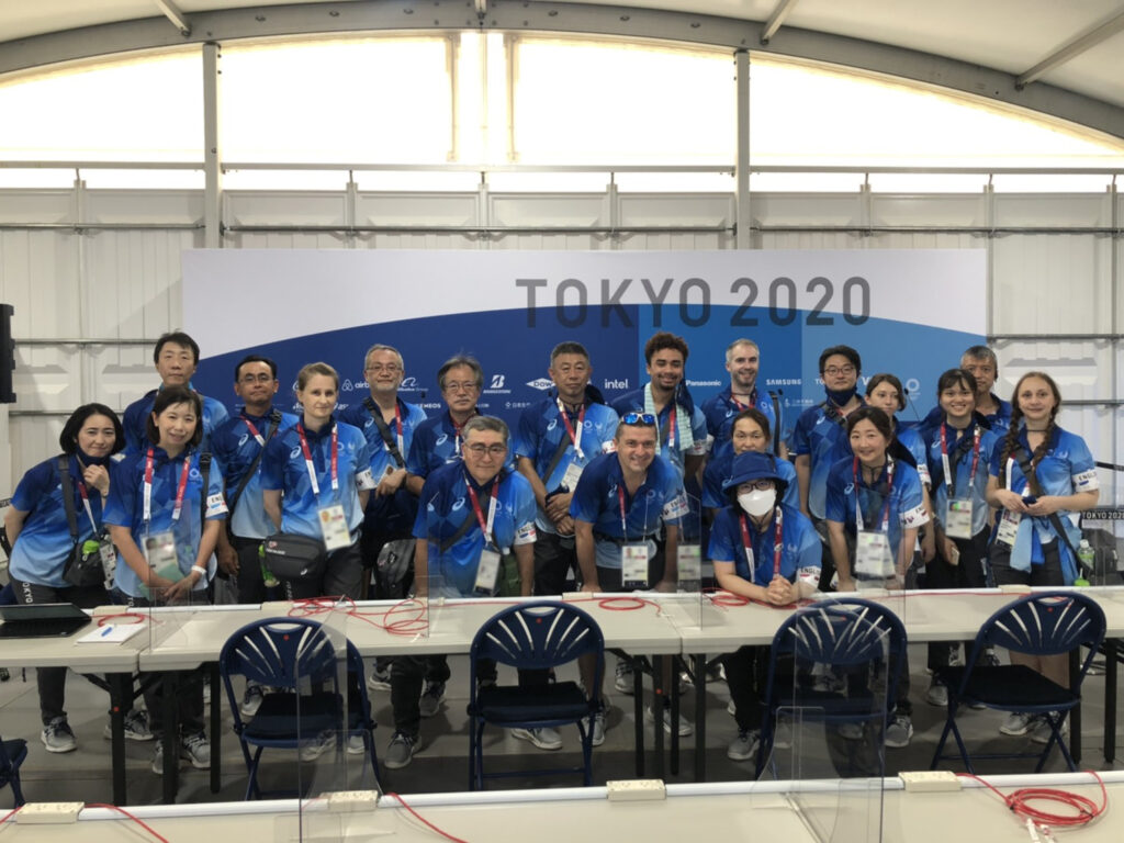 Chris Baylor '22 poses with a group of translators at the Tokyo Summer Olympics