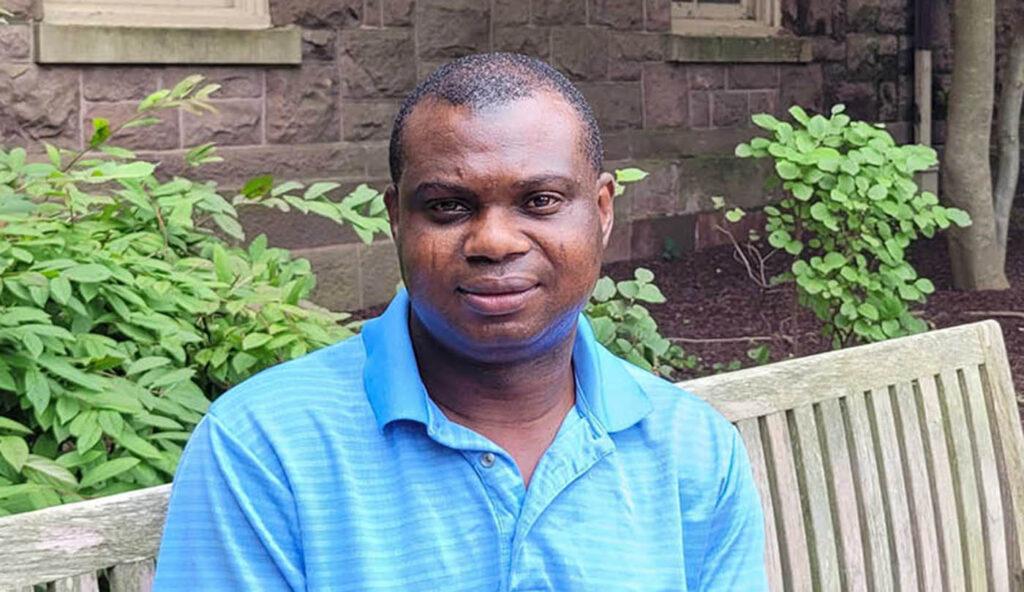 Lanre Akinyem sits on a bench outside Pardee