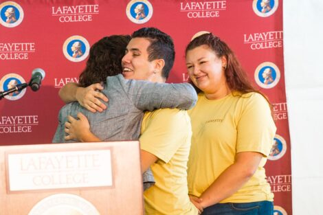 Students hug President Nicole Hurd.