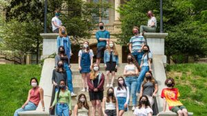 members of Refugee Action club wear masks on steps outside Pardee Hall