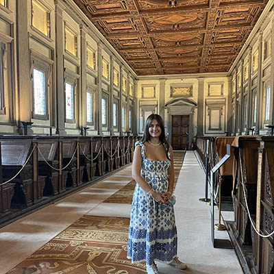 Mallory Brown stands in reading room of Michelangelo designed library in Florence
