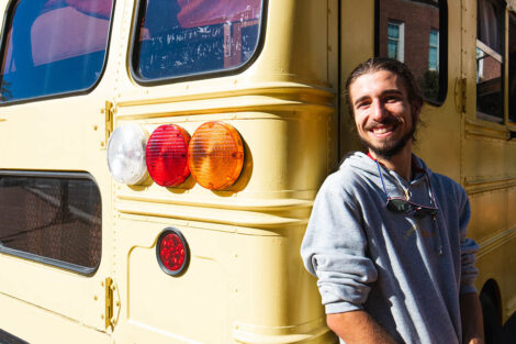 Remy Oktay '23 outside of converted school bus.