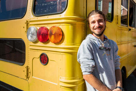 Remy Oktay '23 outside of converted bus.