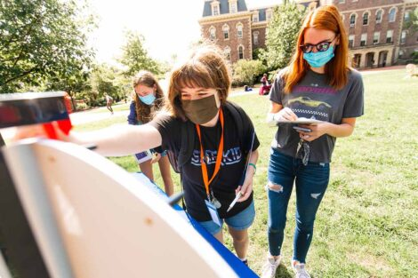 students in masks gather on Quad for Thrive event