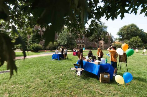 tables with people gathered to learn about Thrive on the Quad