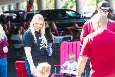 Families mingle on Markle Parking Deck while tailgating.