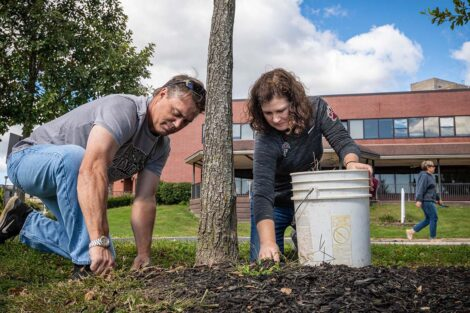Bill Hurd and President Nicole Hurd tend to weeds at Riverside Park.