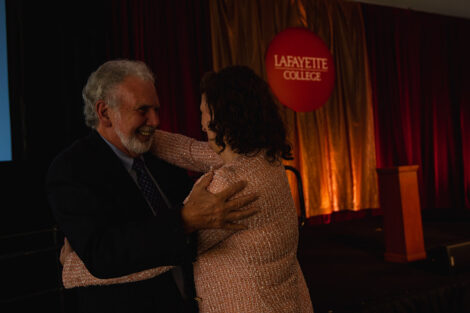 Nicole Farmer Hurd hugs John Sexton