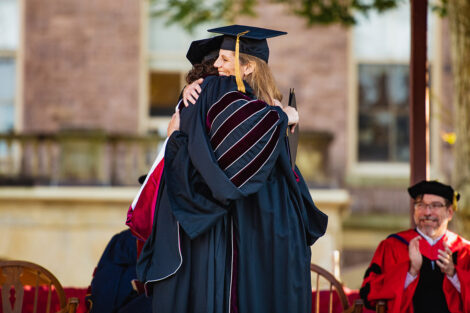 Nicole Farmer Hurd and Linda Assante Carrasco hug