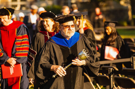 Prof. Ilan Pelig leads the procession after the ceremony, Hurd smiles in background