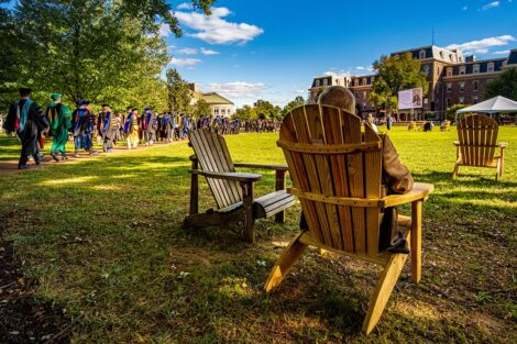 Chairs on the Quad, filled with people.
