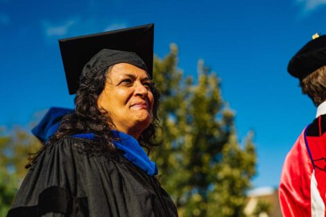 Jamila Bookwala in academic regalia smiles.