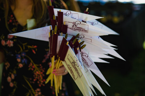 A person holds Lafayette College flags.