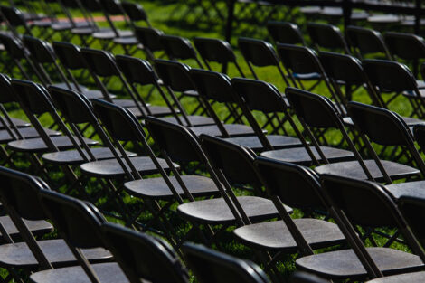 Organized rows of empty folding chairs