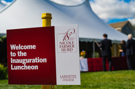 A sign readsWelcome to the Inauguration Luncheon in front of a large white tent.