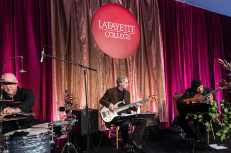 musicians play instruments under a Lafayette College