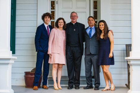 President Hurd with son Matthew, husband Bill, and daughter Monica with minister in front of president's residence